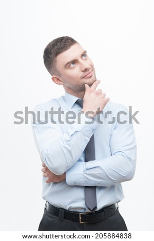 Junior handsome manager in necktie showing process of idea search, holding finger on chin isolated on white, concept pondering - stock photo