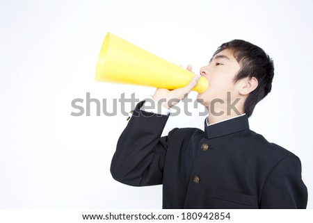 Junior high-Japanese boy screaming through a megaphone