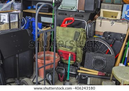 Junk filled corner of storage garage.   - stock photo