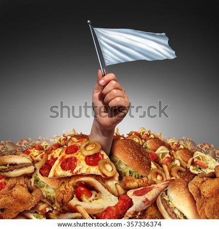 Junk food surrender and giving up fatty food or quitting a high fat lifestyle and dieting help concept as a hand holding a white flag drowning in a heap of greasy snacks. - stock photo