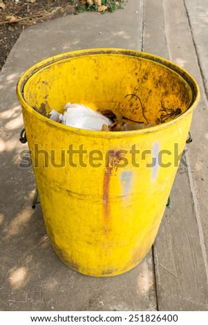 junk in yellow garbage bins  - stock photo