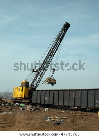 junk yard magnet and crane - stock photo