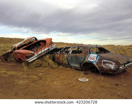 Junky abandoned rusting cars in the desert along historic Route 66 - stock photo