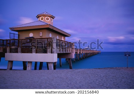 Juno beach twilight tide with dramatic sky and blue waters at Jupiter, Florida, United States - stock photo