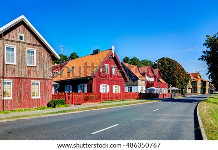 JUODKRANTE, LITHUANIA - 18 SEPTEMBER 2016: Traditional Lithuanian wooden and half-timber houses in the countryside. Juodkrante village, Lithuania.