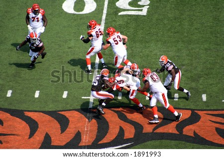 Just as he gets tackled - stock photo