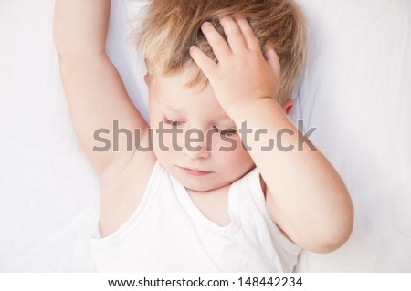 Just awaked boy. Portrait of a cute handsome child awakened - stock photo