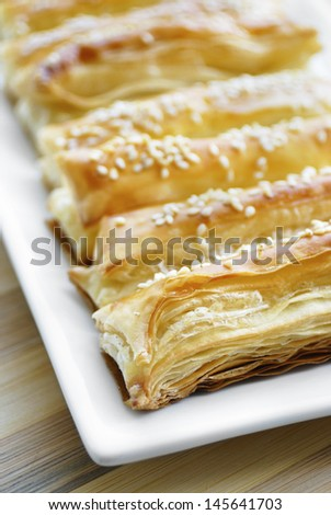 Just baked crunchy puff pastry on the white table