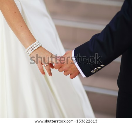 just be with me and never let me go, hands of a young newly wed couple