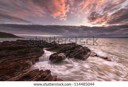 Just before sunset at Whitsand Bay, Cornwall, UK - stock photo