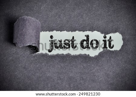 just do it  word under torn black sugar paper  - stock photo