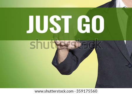 Just Go word Business man touch on vintage yellow green tab virtual screen - stock photo