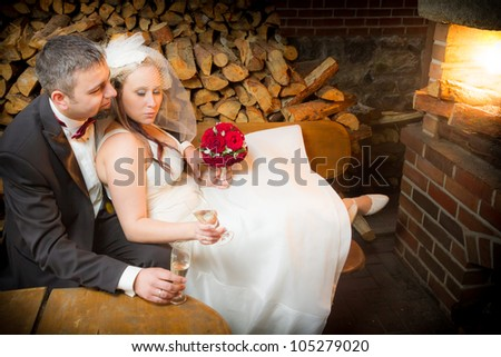 Just Married couple celebrating with champagne - stock photo