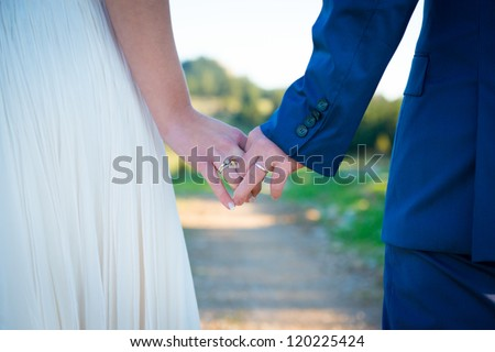 Just married couple holding hands - stock photo