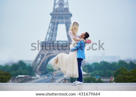 Just married couple in Paris, France. Beautiful young bride and groom near the Eiffel tower. Romantic wedding in Paris concept
