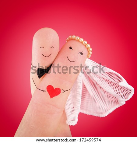 just married couple, newlyweds painted at fingers against red background, good use for wedding invitation card - stock photo