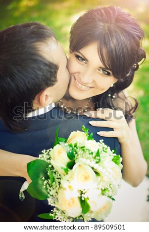 just married couple on green grass in field - stock photo