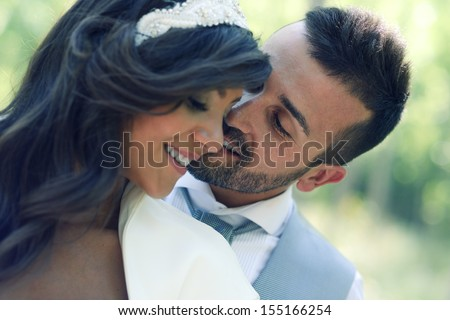 Just married couple together in urban background - stock photo