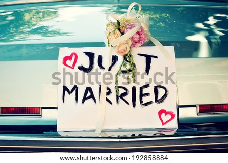 Just Married Sign on a Vintage Car - stock photo