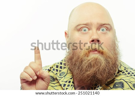 Just unbelievable. Portrait of funny bearded man pointing up with a surprised face expression while standing isolated over white background - stock photo
