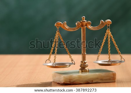 justice concept, scales of justice on desk