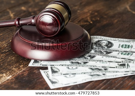 Justice gavel and money on the desk