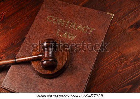 Justice gavel on Law Book - stock photo