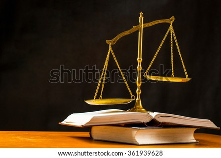 Justice of scale with books on the table. - stock photo