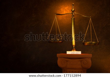 Justice scale on Greek column - stock photo