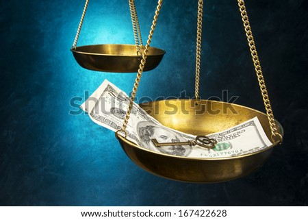 Justice scales with money and key - stock photo