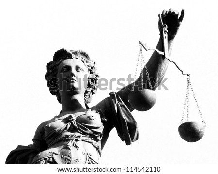 Justice statue in black and white - stock photo