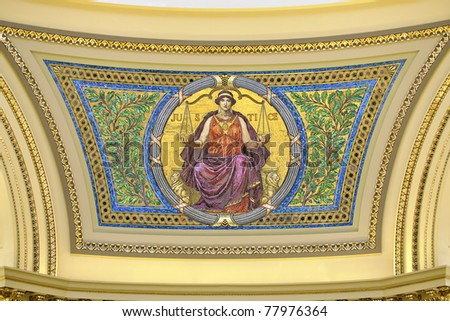 Justice tile mosaic on southeast side of dome in Madison state capitol of Wisconsin - stock photo