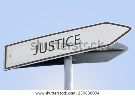 Justice word on road sign - stock photo