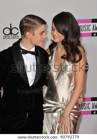 Justin Bieber & Selena Gomez arriving at the 2011 American Music Awards at the Nokia Theatre, L.A. Live in downtown Los Angeles. November 20, 2011  Los Angeles, CA Picture: Paul Smith / Featureflash