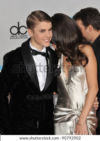 Justin Bieber & Selena Gomez arriving at the 2011 American Music Awards at the Nokia Theatre, L.A. Live in downtown Los Angeles. November 20, 2011  Los Angeles, CA Picture: Paul Smith / Featureflash - stock photo