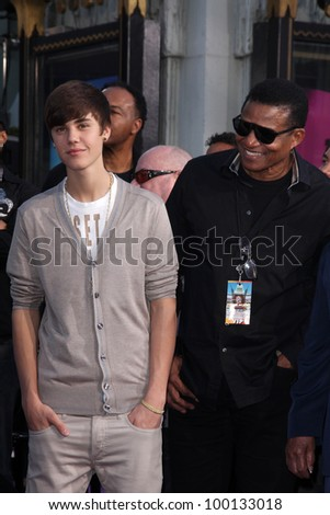 Justin Bieber, Tito Jackson at Michael Jackson Immortalized at Grauman's Chinese Theatre, Hollywood, CA 01-26-12 - stock photo