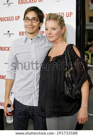 """Justin Long and Kaitlin Doubleday attend Los Angeles Premiere of """"Knocked Up"""" held at the Mann Village Theatre in Westwood, California, on May 21, 2007.   - stock photo"""
