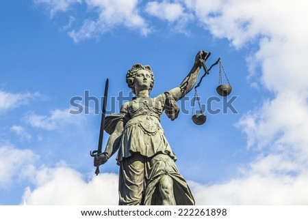 Justitia (Lady Justice) sculpture on the Roemerberg square in Frankfurt, built 1887. - stock photo