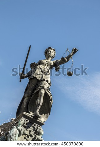 Justitia - Lady Justice sculpture on the Roemerberg squareStatue of Lady Justice (Justitia) in Frankfurt, Germany