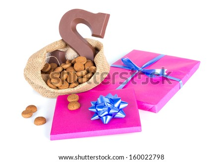 Jute bag with chocolate, ginger nuts and presents; a Dutch tradition at Sinterklaas event in december - stock photo