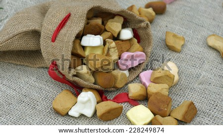 Jute bag with ginger nuts and candies, typical Dutch treat for Sinterklaas on 5 december - stock photo