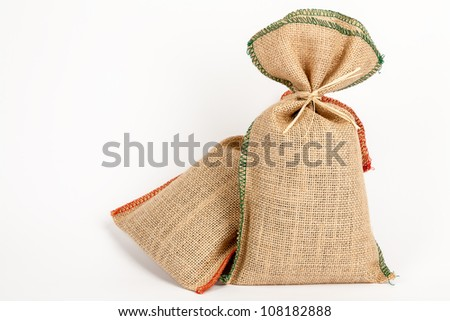 jute bags decorated with colored thread in them, for example, spices - stock photo