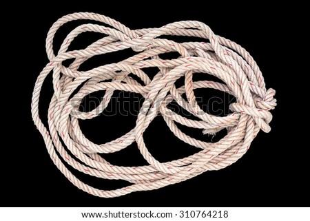 jute rope tangle isolated on black background - stock photo