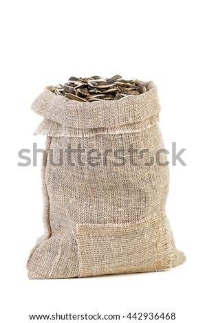 Jute sack with sunflower seeds isolated on white background - stock photo