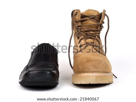 Juxtaposition of black dress shoe with brown work boot. Shot with infinity white background