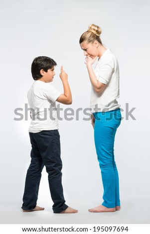 K���°d and mother in confrontation and conflict having issues problems, full body shot - stock photo
