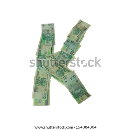 K letter  character- isolated with clipping patch on white background. Letter made of Polish hundred zlotys green bank notes - 100 PLN. - stock photo