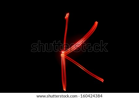 K - torch light alphabet letters - stock photo