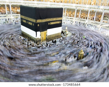 Kaaba the Holy mosque in Mecca with Muslim people pilgrims of Hajj praying in crowd (newest and very rare images of Holiest mosque after latest widening 2013-2014) - stock photo