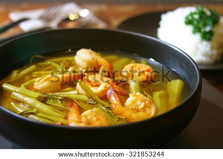 Kaeng Som Kung is shrimp curry with morning glory delicious spicy, health and cuisine food Thailand with rice.  - stock photo